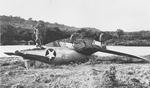 Crashed F4U-1 Corsair of Marine Squadron VMF-123 or VMF-124, mid-1943, probably at Henderson Field, Guadalcanal