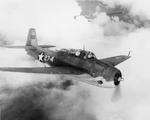 "An in-flight view of a TBF-1 Avenger ""Daisy Mae"" of Marine Squadron VMSB-131 based at Henderson Field, Guadalcanal, Solomons, 1943"