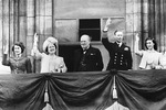 The British Royal family and Prime Minister Winston Churchill responding to the cheering crowds on the surrender of Germany, Buckingham Palace balcony, London, England, United Kingdom, May 8, 1945.