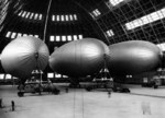 Three US Navy K-class airships from Airship Patrol Squadron ZP-11 inside Hangar One at NAS South Weymouth, Massachusetts, United States, Dec 6, 1942.
