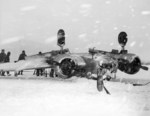 US Navy Beech SNB Expeditor (BuNo 39967) after nosing over on a snow covered runway at NAS South Weymouth, Massachusetts, United States, Feb 8, 1945.