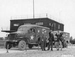 WC-27 ambulances of the 70th Service Group await the return of the 386th Bomb Group's B-26 Marauders, RAF Great Dunmow, Essex, England, United Kingdom, Oct 5, 1943
