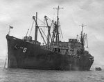 Attack Cargo Ship USS Algorab at anchor circa 1943, location unknown. Note LCVP coming alongside.