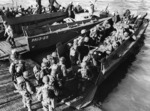 US Army troops board an LVCP landing craft from Amphibious Transport Ship USS Joseph T Dickman at Torquay Hards, England, United Kingdom for a landing exercise in preparation for the Normandy invasion.