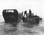 US Marines practice transferring troops from LCVP landing craft to LVT Water Buffalo in the Solomons preparing for the landings on Guam, Marianas, mid-1944.
