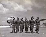 A group of US Navy flight nurses walking away from a Douglas R5D Skymaster aircraft, Guam, Marianas, Apr 1945