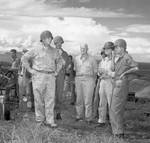Secretary of the Navy Frank Knox, left, touring Guadalcanal with Adm Nimitz, Adm Halsey, and Army Gen J Lawton Collins, Jan 21, 1943. Apparently no one thought to tell Knox his helmet was on backwards.