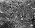 Overhead view of US Marine LVT passing artillery positions on Iwo Jima, Feb 20, 1945