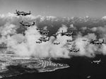 "Col James Beckwith, commander of the 15th Fighter Group, in his P-51 Mustang ""Squirt"" leading P-51s of the 45th Fighter Squadron from their base on Saipan to their new base on Iwo Jima, Mar 7, 1945. Note the VLR tanks."