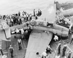TBM Avenger of Composite Squadron VC-76 after a crash landing aboard the Escort Carrier USS Petrof Bay, 1945