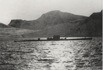 Type IXC/40 submarine U-537 at anchor in Martin Bay, Labrador, Dominion of Newfoundland (now Canada) on 22 Oct 1943. Crewmen can be seen on deck offloading components of Weather Station Kurt into rubber rafts.