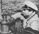 Commanding Officer Kapitänleutnant Peter Schrewe on the bridge of the German Type IXC/40 submarine U-537, Atlantic Ocean, Oct 1943.