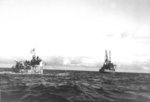 Oceangoing tug USS Abnaki takes the captured Type IXC submarine U-505 under tow, 7 Jun 1944. U-505 was captured three days earlier by the USS Guadalcanal hunter group. Photo 2 of 3.