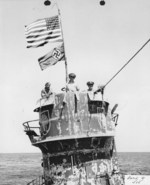 US Navy officers on the bridge of the captured U-505, 14 Jun 1944, Cdr Earl Trosino, Capt Daniel Gallery, and Lt(jg) Albert David. The U-505 was captured by Capt Gallery's hunter group built around the USS Guadalcanal