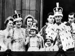 King George VI, Queen Elizabeth, and the Princesses Elizabeth and Margaret of the United Kingdom appear on the balcony of Buckingham Palace on the king's coronation day, London, England, United Kingdom, 12 May 1937
