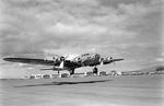 Early model Boeing B-17 Fortress taking off from Hickam Field, Oahu, Territory of Hawaii, pre-war, Aug 1941.