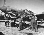 Chinese and American armorers checking the guns on a Curtiss P-40E Warhawk of the 74th Fighter Squadron, 23rd Fighter Group at Kunming, China, 1 Feb 1943