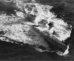 Type IXC/40 U-Boat U-185 foundering in the mid-Atlantic after an aerial depth charge attack by a TBF-1 Avenger from Escort Carrier USS Core, 24 Aug 1943. 36 were rescued while 43 perished.