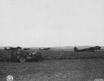 US Army personnel observing dummy Junkers Ju-88 bombers left behind at the airfield at Épinay, France, 2 Sep 1944.