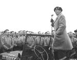 Field Marshal Bernard Montgomery standing in a Jeep while addressing American troops in Devon, England, United Kingdom, 15 Jan 1945. The bare-headed soldiers suggest this was a worship or memorial service.