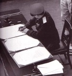 General Kuzma Nikolaivich Derevyenko signing the surrender instrument on behalf of the Soviet Union aboard USS Missouri, Tokyo Bay, Japan, 2 Sep 1945, photo 2 of 2