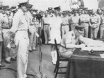 Air Vice-Marshal L.M. Isitt signing the surrender instrument on behalf of the Dominion of New Zealand aboard USS Missouri, Tokyo Bay, Japan, 2 Sep 1945