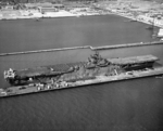 USS Yorktown (Essex-class) at the Alameda Naval Air Station loading aircraft and vehicles for transportation to the Pacific, 14 Sep 1943. Note three PV-1 Venturas on the after flight deck. Photo 1 of 2.