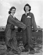WASP cadets Leonora Anderson and Mildred Axton show off the oversized and ill-fitting jump suits provided to the WASP program, Avenger Field, Sweetwater, Texas, United States, May 1943.
