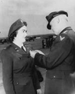 "WASP pilot Barbara Erickson being awarded the Air Medal from the Army Air Forces Commanding General, Henry ""Hap"" Arnold, during the graduation ceremony for WASP cadet class 44-W-2, Avenger Field, Texas, 11 Mar 1944"