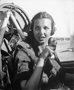 WASP pilot Nancy Nesbit seated in the cockpit of an AT-6 Texan at Love Field, Dallas, Texas, United States, 1944