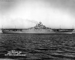 Broadside view of USS Intrepid off Norfolk Navy Yard, Portsmouth, Virginia, United States, 25 Nov 1943. Note the blank starboard side of the ship; later photos will show the addition of anti-aircraft gun sponsons.