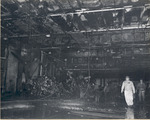 Damage control parties trying to bring fires under control on the hangar deck of USS Intrepid following the crash of a Japanese special attack aircraft off the Philippines, 25 Nov 1944