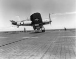 "F4U-1 Corsair of VF-17, ""The Jolly Rogers,"" landing aboard the carrier Bunker Hill south of Bermuda during her shakedown cruise, 17 July 1943. Photo 2 of 2"