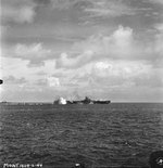 Carrier USS Bunker Hill taking a near miss from a Japanese dive bomber close aboard the starboard quarter, 19 Jun 1944 off Guam, Mariana Islands. The ship was not damaged. Photo 1 of 2