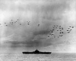 The US Third Fleet steaming in tight formation for a photo opportunity as close to 200 airplanes fly overhead, 22 Aug 1945. Photo taken from USS Wasp (Essex-class). Carrier seen is almost certainly the USS Randolph.
