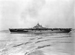 USS Wasp (Essex-class) shifting berths at the New York Navy Yard Annex at Bayonne, New Jersey, United States, 16 Nov 1945. Wasp had just been fitted out as a troop transport for Operation Magic Carpet.
