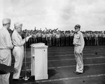 US Navy Admiral William Halsey presenting Vice-Admiral John McCain with the Navy Cross on the flight deck of USS Hancock at anchor in the Ulithi Lagoon, Caroline Islands, 30 Nov 1944.