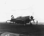Tailhook of an F4U Corsair from Fighting Squadron VBF-6 hooking an arresting cable aboard USS Hancock off Okinawa, Japan, 21 Mar 1945. Note aircraft tractor tug in the foreground.