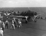F6F-3 Hellcats preparing for launch from USS Saratoga for strikes against Tarawa, Gilbert Islands, mid Nov 1943.
