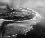 Strike photo of Kwajalein, Marshall Islands taken by aircraft from USS Enterprise, 30 Jan 1944. Note the Kwajalein radio complex in the clearing in the foreground that was a key Japanese listening post in the Pacific.