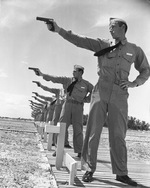 Naval Aviation Cadets from the Naval Air Station at Corpus Christi at the pistol range with Colt M1911-A1 .45 caliber pistols, Corpus Christi, Texas, United States, circa 1941.