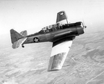 North American SNJ-4 Texan advanced trainer in flight over Naval Air Station at Corpus Christi, Texas, United States, Mar 1943