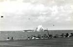 A Japanese special attack A6M aircraft crashing close aboard the starboard side of the carrier Ticonderoga off the Philippines, 5 Nov 1944. Photo 1 of 3.