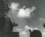 A Mitsubishi A6M Zero special attack aircraft diving on the carrier Lexington (Essex-class) off the Philippines, 5 Nov 1944. This plane struck the carrier directly outboard of the secondary conn causing moderate damage