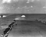 The USS Enterprise conducted flight training when steaming from Hawaii to Tonga on 15 Jul 1942. Here an F6F Hellcat fighter crashed into the sea when approaching the carrier for a landing; pilot rescued.