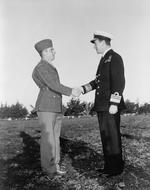 US Army Ranger Sergeant Franklin Koons shaking hands with British Vice Admiral Louis Mountbatten immediately following being presented with Great Britain's Military Medal at Casablanca, French Morocco, 18 Jan 1943