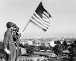 US Army honor guard presenting the colors outside the President's villa 'Dar es Saada' in the Anfa neighborhood of Casablanca, French Morocco during the Casablanca Conference, Jan 1943.