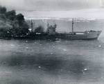 Japanese Type 2AT tanker Otsusan Maru burning and heading for the beach on the coast of French Indochina (Vietnam) north of Qui Nhon after its convoy was attacked by 175 United States Navy carrier planes, Jan 12, 1945.