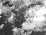 Photo through the cloud cover taken from aircraft from Bombing Squadron VB-14 from the USS Wasp (Essex-class) showing the discovery of a Japanese warship underway, 1944