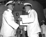 Fleet Admiral Chester Nimitz presenting Admiral William Halsey with a gold star in lieu of a fourth award of the Navy Distinguished Service Medal aboard USS Missouri in Pearl Harbor, 28 Sep 1945.